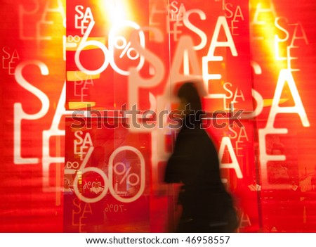People in the mall during the sale. Blurred motion - stock photo