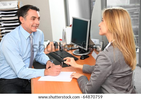 People in the office signing contract - stock photo