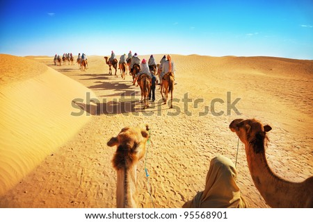 People in the Sahara desert - stock photo