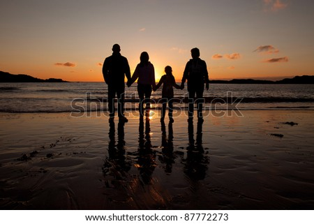 People in the Sunset at Trearddur Bay on the Isle of Anglesey