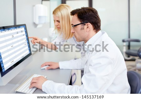 People in uniform in a laboratory - stock photo