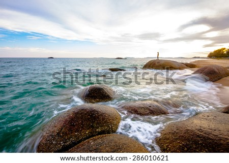 people in view of a rocky coast - stock photo