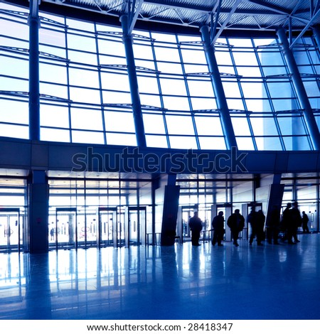 People in wide blue hall window in exposition center, square copmosition - stock photo