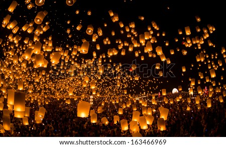 People launch sky lanterns