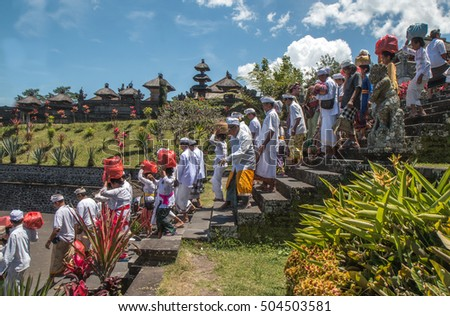 People leaving Besakih temple after prayer. Bali, Indonesia - 12/SEP/2016
