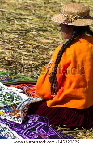 People living in Uros Floating Islands, Lake Titicaca, Peru - stock photo