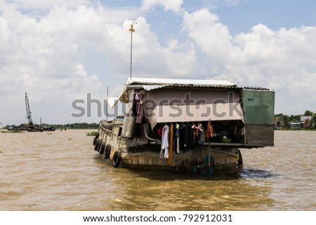 People living on the wooden boats of the Mekong floating market, Vietnam