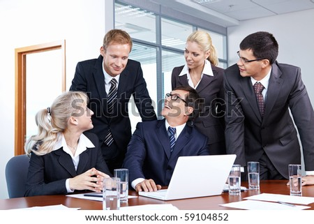 People look at an employee in the office - stock photo