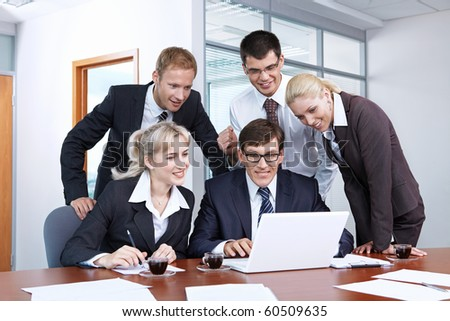 People look at the laptop in the office - stock photo