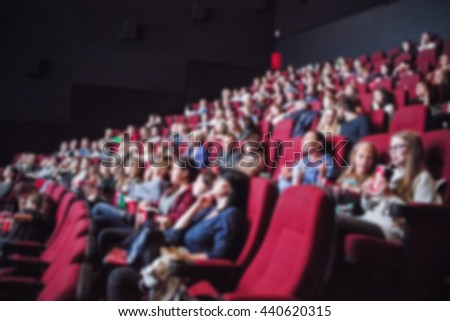 People looking at the screen at cinema.