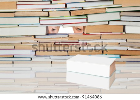 People looking for a number of books on a white book. - stock photo