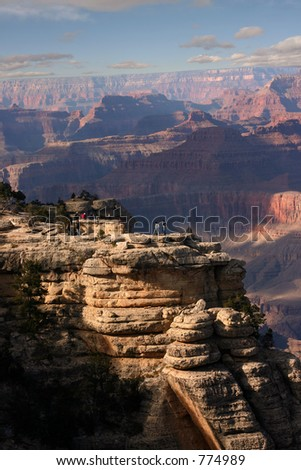 People looking out onto the grand canyon. - stock photo