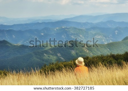 People looking panorama of Casentino forest,Italy - stock photo