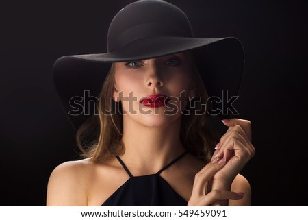 people, luxury and fashion concept - beautiful woman in black hat over dark background