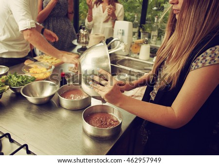 People making food in home and restaurant kitchen in workshop
