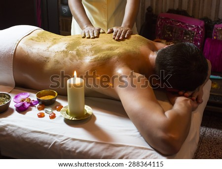 people man engaged in Ayurvedic spa treatment - stock photo