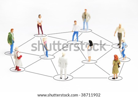 people miniature figurines connected, as concept for social networking - stock photo