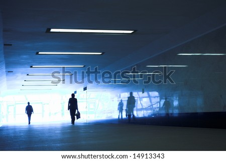 People mooving in hall corridor - stock photo