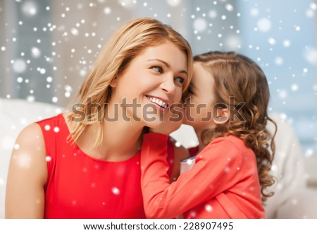 people, motherhood, family, winter and adoption concept - happy mother and daughter whispering something into ear at home - stock photo