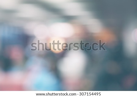 People moving at the airport in abstract art out of focus blur - stock photo