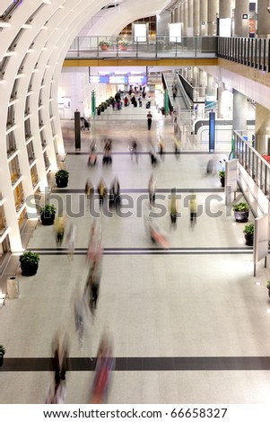 people moving blur in corridor - stock photo