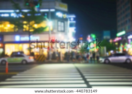 People moving in crowded night city street ,Korea , Blur background - stock photo