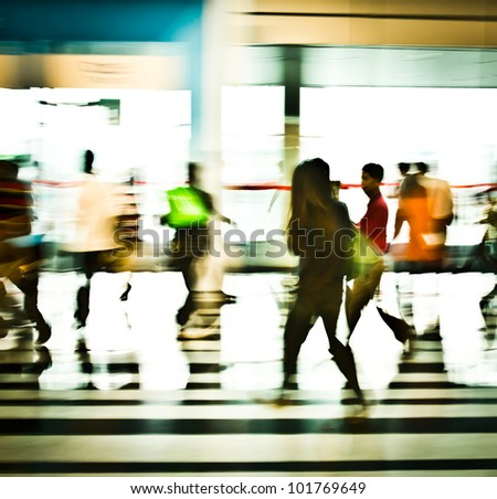 people moving in the office lobby deliberately blurred action,abstract image - stock photo