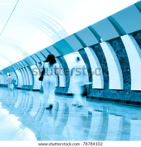 people moving inside metro station - stock photo