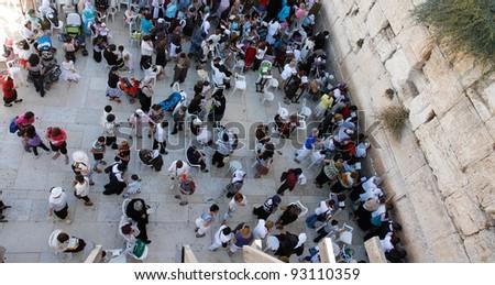 people near wailing wall in Jerusalem - stock photo