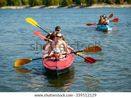 People of all ages in a kayak. Family holiday.