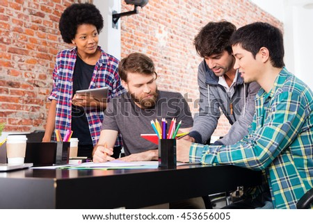 People office diverse mix race group businesspeople working sitting desk looking tablet computer casual wear - stock photo