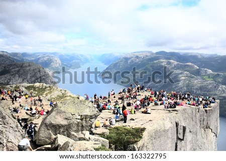 people on a Preacher�s Pulpit with a Lysefjord on a background  - stock photo