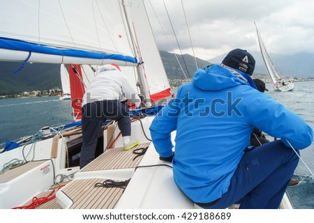"People on board the yacht. Tivat, Montenegro - 28 April, 2016. Regatta ""Russian stream"" in God-Katorskaya bay of the Adriatic Sea off the coast of Montenegro. - stock photo"