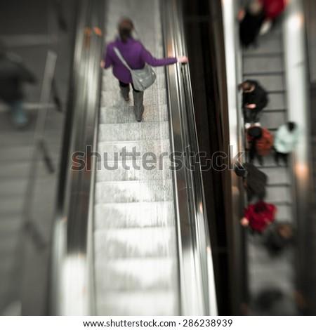 People on Escalator - stock photo