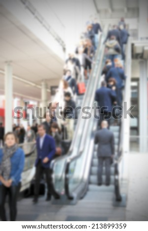 People on escalator, intentionally blurred post production