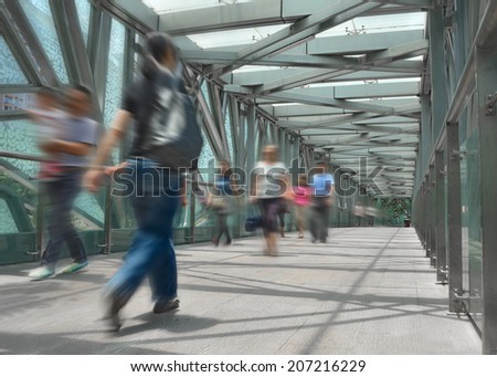 People on footbridge - stock photo