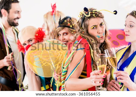 People on party drinking champagne and celebrating birthday or new years eve - stock photo
