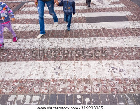 People on pedestrian crossing. - stock photo