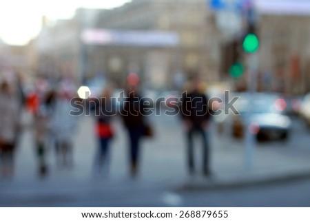 People on pedestrian crossing bokeh - stock photo