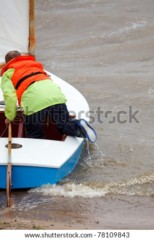 People on sailing boat on the sea - stock photo