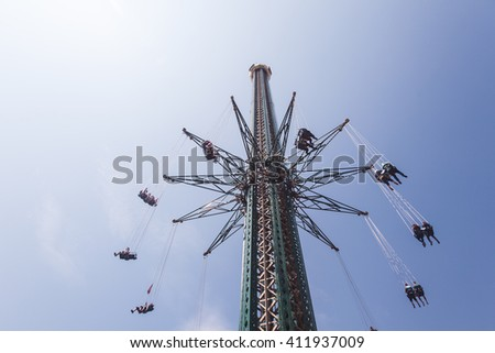 people on sky high carousel  - stock photo