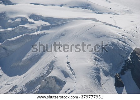 people on snow in the mountains