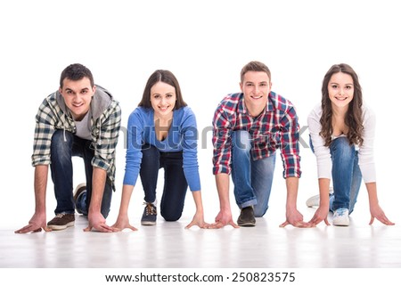 People on starting line. Group of young people are standing on starting line and are looking forward while isolated on white. - stock photo