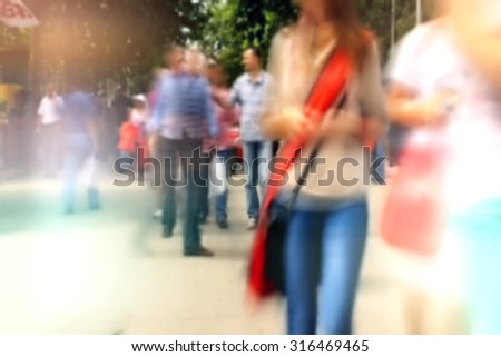 People On Street out of focus , Unrecognizable Crowd out of Focus - stock photo