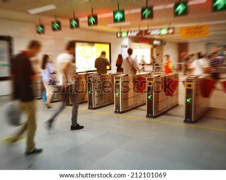 people on subway station blur motion - stock photo