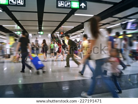 People on subway station blur motion - stock photo