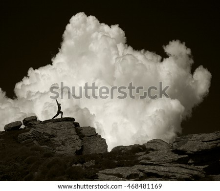 people on the background of clouds make an asana
