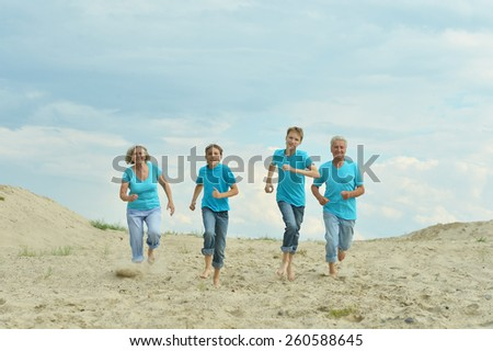 people on the background of sand and blue sky - stock photo