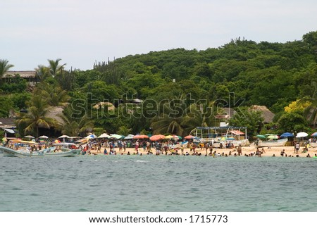 People on the beach at Puerto Escondidio, Mexico - stock photo