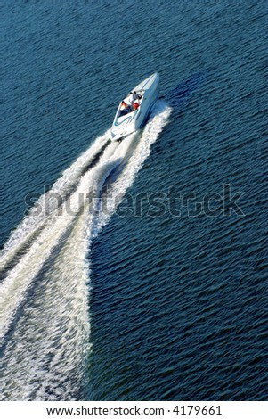 People on the boat racing - stock photo